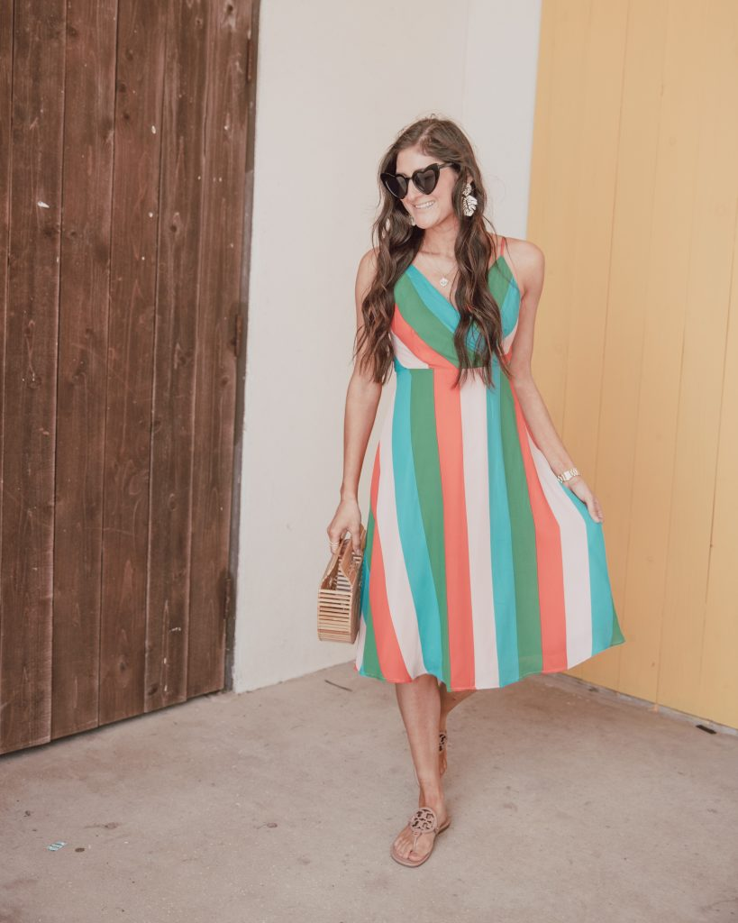Jenni Metz from The Fashionable Maven blog is wearing a cute striped dress outfit with Tory Burch sandals. Bamboo bag, heart sunglasses. Click to see the cute striped dress outfits.